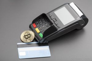 Bitcoin,POS-terminal and credit card.business concept over black
