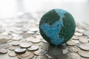 global money, mock up globe on dollar coins. concept of financial world, finance and banking international.