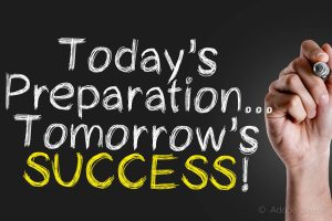 Hand writing the text: Todays Preparation... Tomorrows Success!