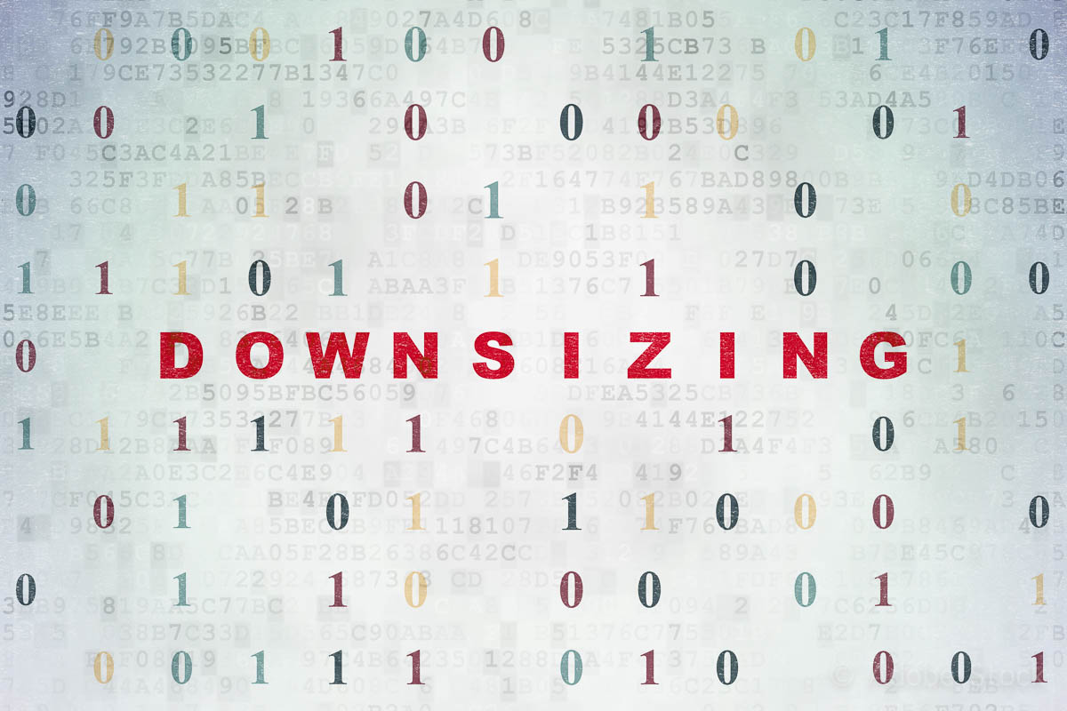 Business concept: Downsizing on Digital Data Paper background